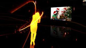 Silhouette dancing while a video of a family at Christmas time appears to the right