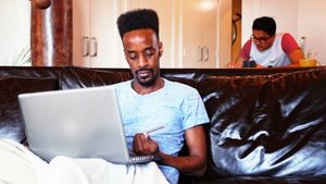 Man doing online shopping on laptop