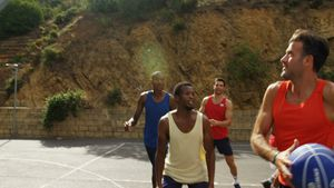 Basketball players practicing in basketball court