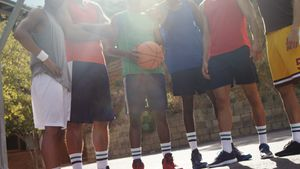 Basketball players standing together in basketball court outdoors