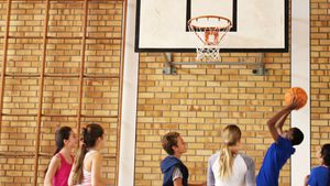 Group of high school kids playing basketball