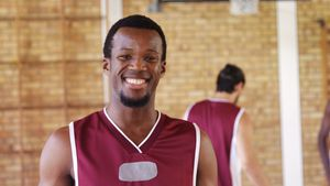 Smiling basketball player holding a basketball