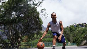 Basketball player practicing dribbling