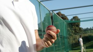 Cricket player holding ball during a practice session
