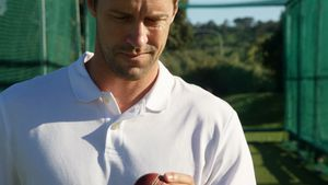 Confident cricket player holding ball during a practice session