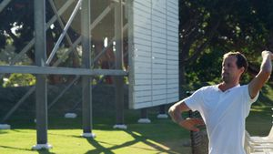 Cricket player bowling in the nets during a practice session