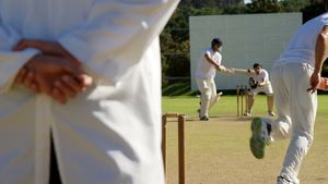 Bowler delivering ball during cricket match
