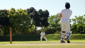 Wicket keeper taking a catch during cricket match