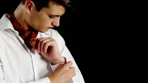 Androgynous man adjusting his hand cuffs