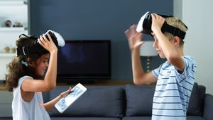 Kids using virtual reality headset in living room