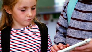 School kids using digital tablet