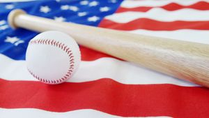 Baseball and baseball bat on an American flag