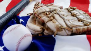 Baseball, baseball bat and  baseball gloves on an American flag