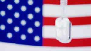 Dog tag hanging against American flag background
