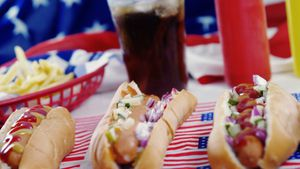 Hamburgers and cold drink served on American flag