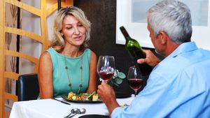 Mature couple interacting with each other in restaurant