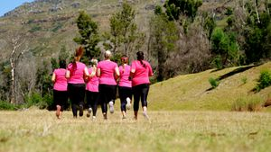 Group of women running while training in the boot camp