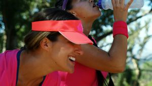 Women drinking water after workout in the boot camp