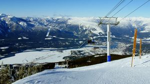 Overhead cable cars above snowcapped mountain