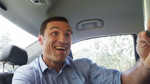 Man taking a selfie on mobile phone in the car