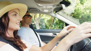 Couple together in a car on road trip