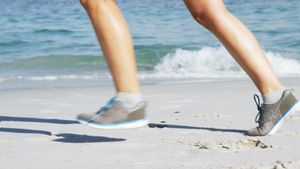 Fit woman jogging on the beach
