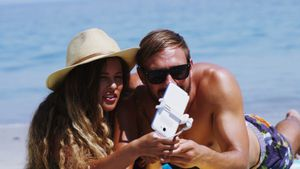 Couple taking selfie from mobile phone at beach