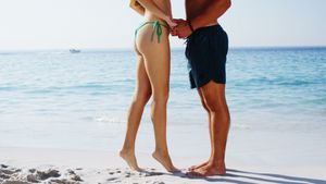 Romantic couple standing at beach