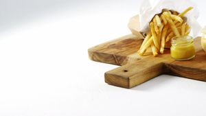 Snacks with dip on chopping board