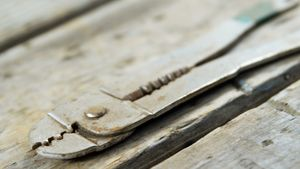 Vintage work tool on wooden plank