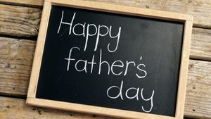 Happy fathers day message written on slate
