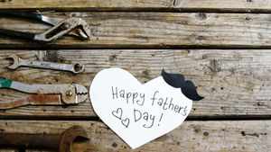 Happy fathers day card with old work tools on wooden plank