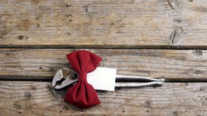 Decorated plier and vintage work tools on wooden plank
