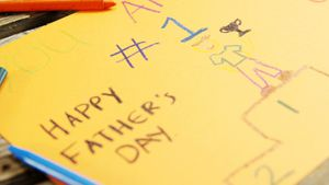 Paintings and happy fathers day message on paper