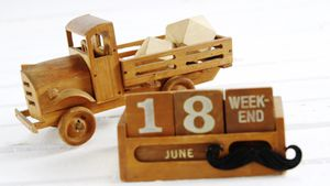 Toy truck with date block arranged against white background