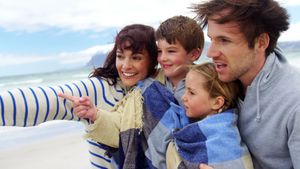 Happy family enjoying at beach