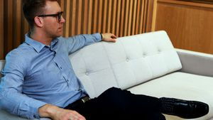 Male executive relaxing on sofa