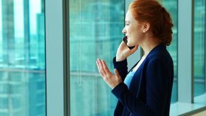 Female executive talking on mobile phone