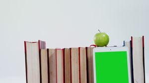 Apple, digital tablet and books on white background
