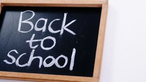 Text back to school written on a chalkboard