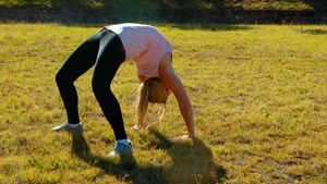 Woman performing stretching exercise during obstacle course