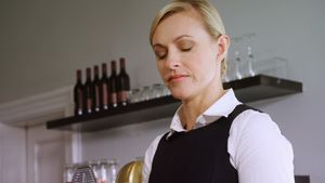 Waitress maintaining record on clipboard