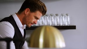 Waiter working at counter in restaurant