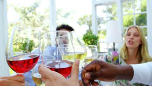 Group of friends toasting glasses of wine