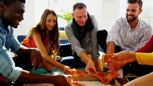 Group of happy executives having pizza