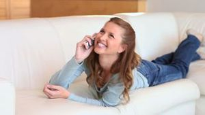 Young happy woman talking on the phone