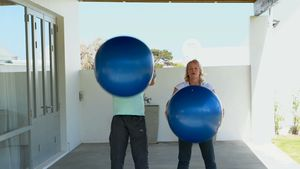 Senior couple exercising with exercise ball