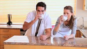 Couple drinking milk together