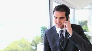 Man in suit talking on a mobile phone