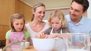 Family making a cake together